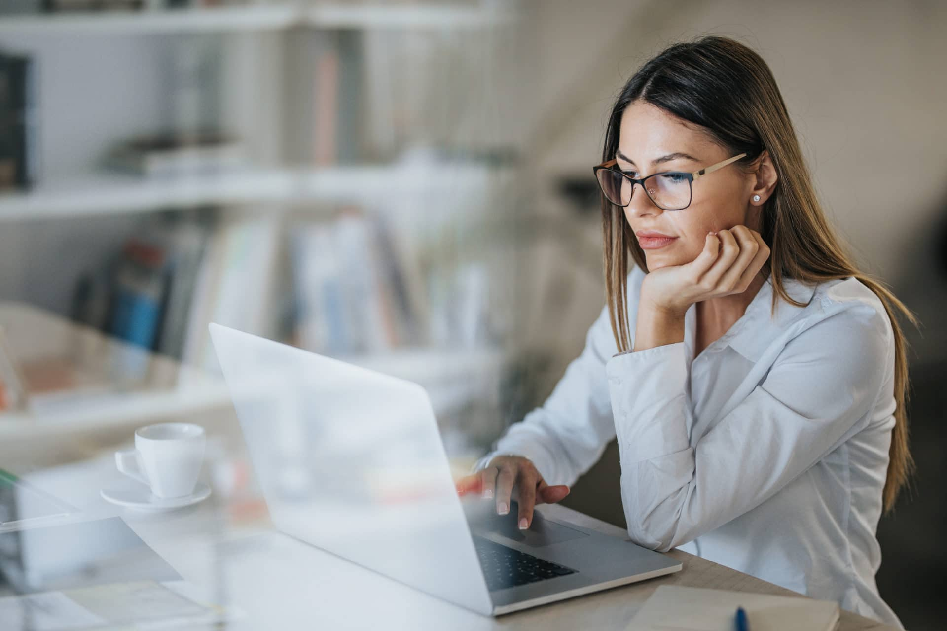 Businesswoman Working From Laptop With Managed IT Services